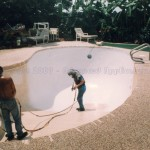 Swimming-Pool---Spraying-fiberglass-coating-over-primer-coat